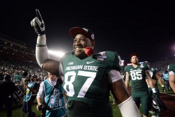 Michigan State's Brandon Clemons #87 walks in the locker room after winning  the 100th Rose Bow game in Pasadena Wednesday, January 1, 2014. Michigan State defeated Stanford 24-20. (Photo by Hans Gutknecht/Los Angeles Daily News)