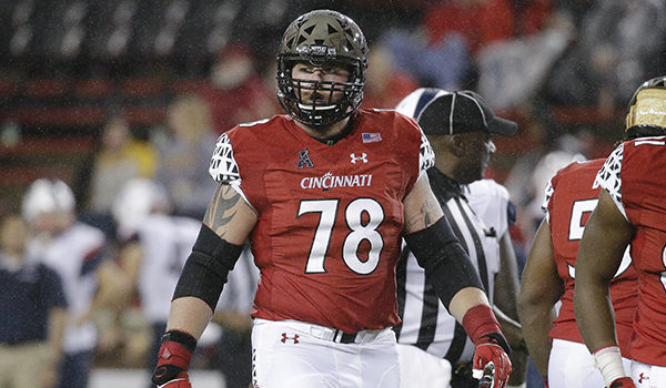 Cincinnati offensive lineman Parker Ehinger (78) walks the field after a play in the second half of an NCAA college football game against Connecticut, Saturday, Oct. 24, 2015, in Cincinnati. Cincinnati won 37-13. (AP Photo/John Minchillo)