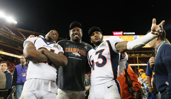 SANTA CLARA, CA - FEBRUARY 07: Aqib Talib #21, Von Miller #58 and T.J. Ward #43 of the Denver Broncos celebrate after defeating the Carolina Panthers 24-10 in Super Bowl 50 at Levi's Stadium on February 7, 2016 in Santa Clara, California. (Photo by Patrick Smith/Getty Images)
