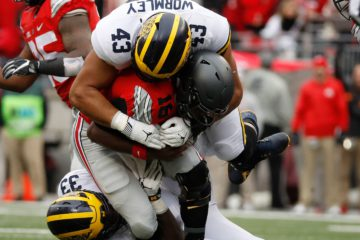 Ohio State quarterback J.T. is tackled by Michigan Wolverines defensive linemen Chris Wormley in the first half at Ohio Stadium on Nov. 26, 2016 in Columbus, Ohio. (Photo: Gregory Shamus, Getty Images)
