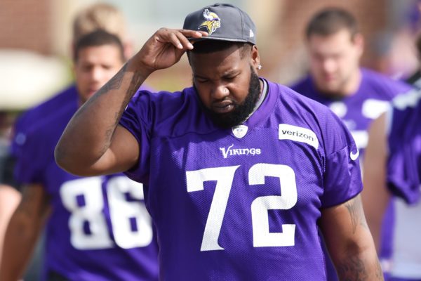Minnesota Vikings offensive lineman Andre Smith adjusts his cap as he walks to the morning walk-thru on the second day of the Minnesota Vikings training camp at Minnesota State University in Mankato on Saturday, July 30, 2016. (Pioneer Press: John Autey)