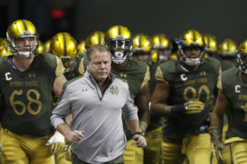 SAN ANTONIO, TX - NOVEMBER 12: Notre Dame head coach Brian Kelly leads his team onto the field before the start of their game against Army in a NCAA college football game at the Alamodome on November 12, 2016 in San Antonio, Texas.  (Photo by Ronald Cortes/Getty Images)