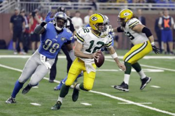 Detroit Lions defensive end Devin Taylor (98) chases Green Bay Packers quarterback Aaron Rodgers (12) during the first half of an NFL football game, Sunday, Jan. 1, 2017, in Detroit. (AP Photo/Carlos Osorio)