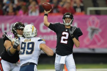 Oct 23, 2016; Atlanta, GA, USA; Atlanta Falcons quarterback Matt Ryan (2) passes over San Diego Chargers defensive end Joey Bosa (99) during the second half at the Georgia Dome. The Chargers defeated the Falcons 33-30 in overtime. Mandatory Credit: Dale Zanine-USA TODAY Sports