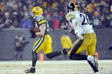 Dec 22, 2013; Green Bay, WI, USA;  Green Bay Packers linebacker A.J. Hawk (50) returns an interception in the 3rd quarter during the game against the Pittsburgh Steelers at Lambeau Field. Mandatory Credit: Benny Sieu-USA TODAY Sports