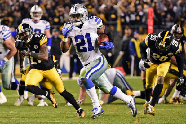 Dallas Cowboys running back Ezekiel Elliott (21) beats Pittsburgh Steelers strong safety Robert Golden (21) and Cortez Allen (28) to the end zone for a touchdown during the second half of an NFL football game in Pittsburgh, Sunday, Nov. 13, 2016. (AP Photo/Fred Vuich)