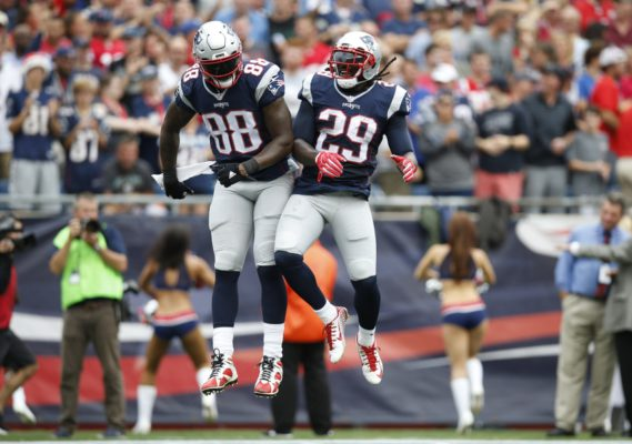 Sep 18, 2016; Foxborough, MA, USA; New England Patriots tight end Martellus Bennett (88) and running back LeGarrette Blount (29) celebrate after scoring a touchdown against the Miami Dolphins during the first quarter at Gillette Stadium. Mandatory Credit: Greg M. Cooper-USA TODAY Sports