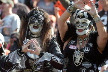 Sep 27, 2015; Cleveland, OH, USA; Oakland Raiders female fans Pati McGaffigan (Mystic Raider), left, and Mary Carpenter (MaskaRaider) react in the fourth quarater against the Cleveland Browns in a NFL game at FirstEnergy Stadium.The Raiders defeated the Browns 27-20.  Mandatory Credit: Kirby Lee-USA TODAY Sports