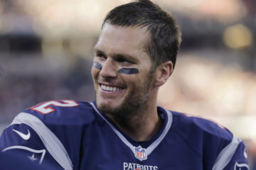 FILE - In this Oct. 11, 2015, file photo, New England Patriots quarterback Tom Brady smiles on the sideline during the second half of an NFL football game against the Dallas Cowboys in Arlington, Texas. The last time Brady and Co. were 8-0 was in 2007, and the Patriots wound up getting all the way to 18-0 before losing to Eli Manning's Giants in the Super Bowl. New York and coach Tom Coughlin defeated New England and coach Bill Belichick in another Super Bowl four seasons later. (AP Photo/Tim Sharp, File) ORG XMIT: NY151