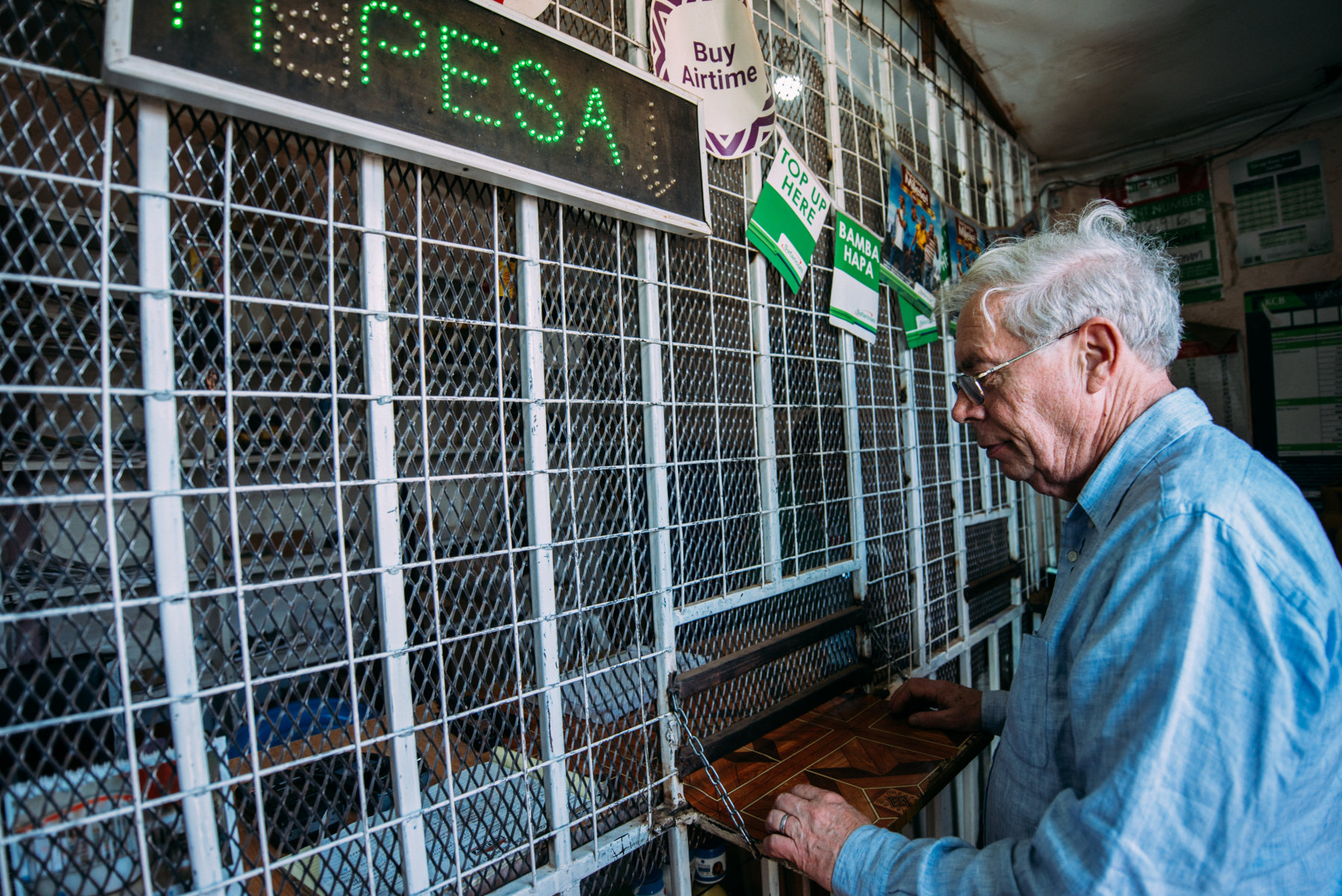John Kay at an Mpesa Agent...can i get my number registered for Mpesa please (FILEminimizer)