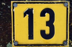 number-13-on-a-road-sign-thirteen