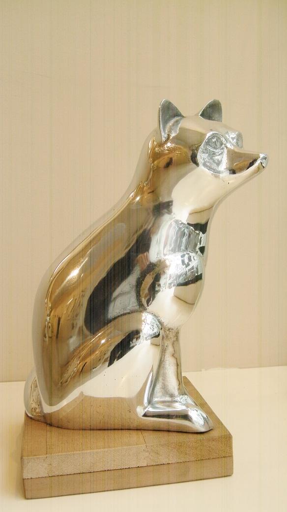 Loek prins  poolvos  aluminium   hoog 34 cm. e. 1950 00