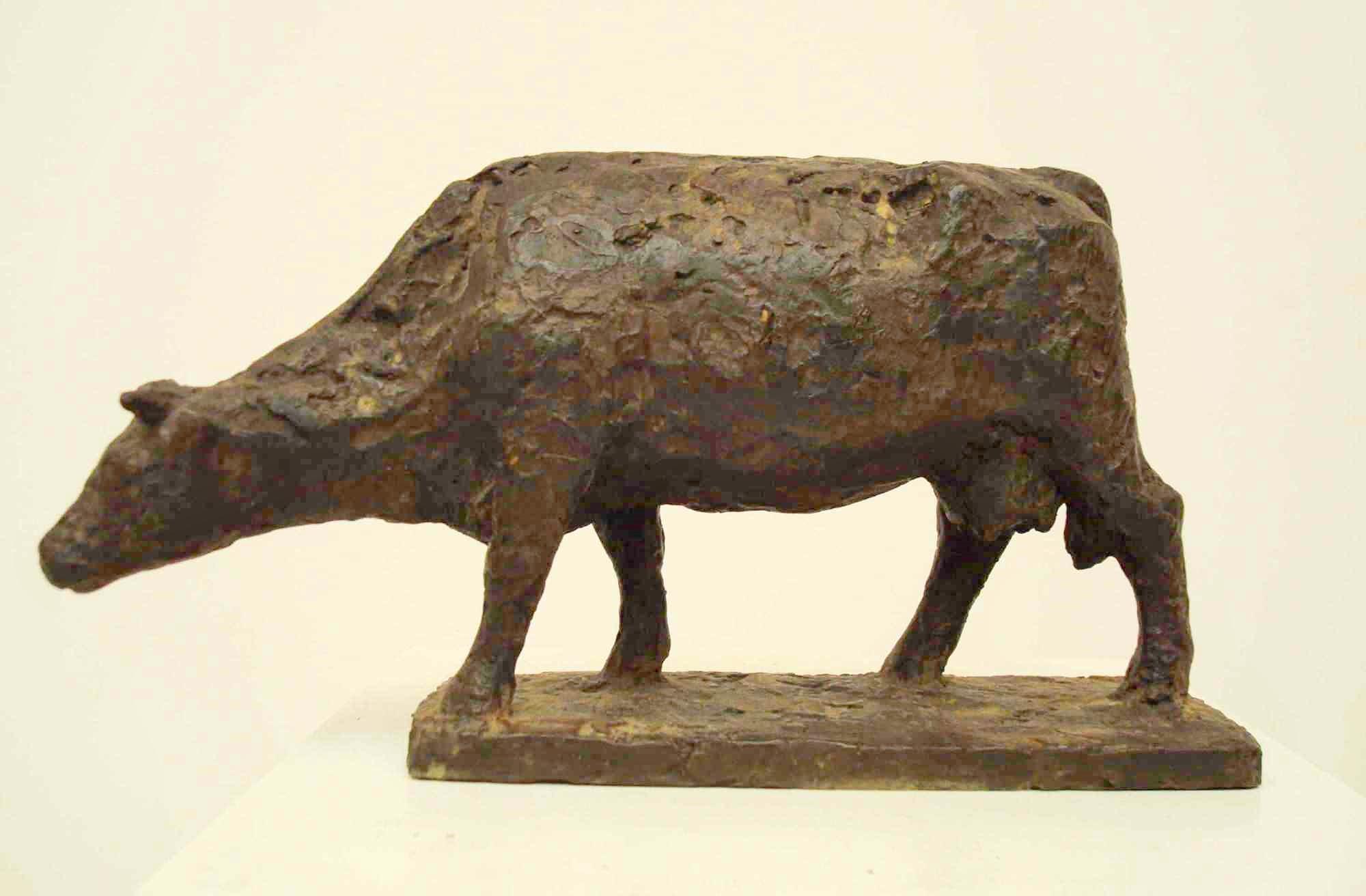 Gerry van der velden   koe  zoekend  brons  hoog 14 cm   800 00