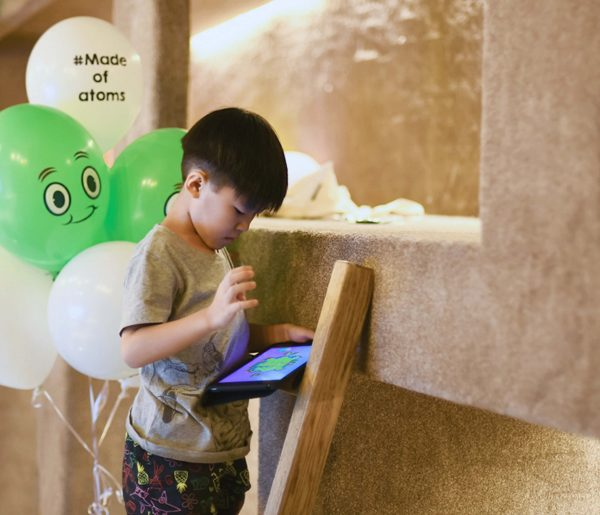 A child playing Big Bang Legends during our release event in Singapore