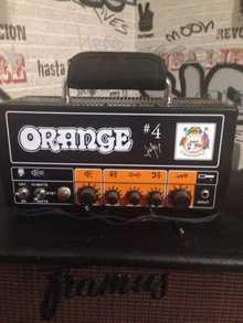 Orange Jim Root signature terror head