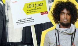 daryll met protestbord 100 jaar vrouwenkiesrecht en activisme