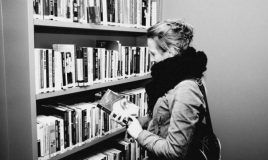 student in library atria