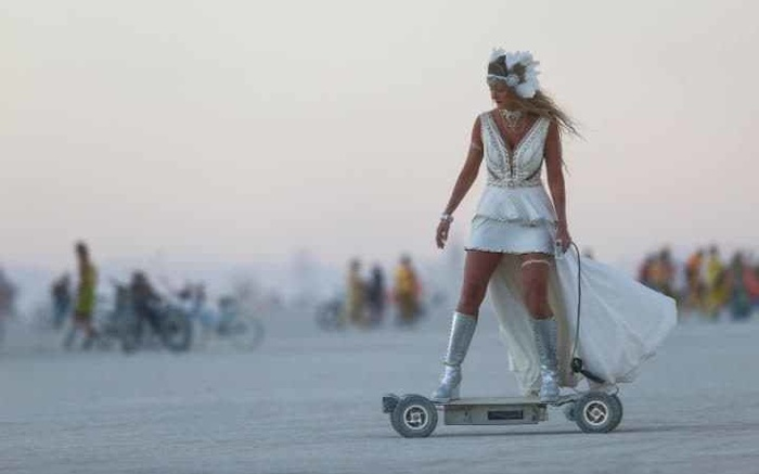 107337995 in this wednesday aug 31 2016 photo a woman rides an electric scooter during burning man a large trans  hqof apyybzdqrcfmcbs5yung2esdos4rg6q1lwpgne
