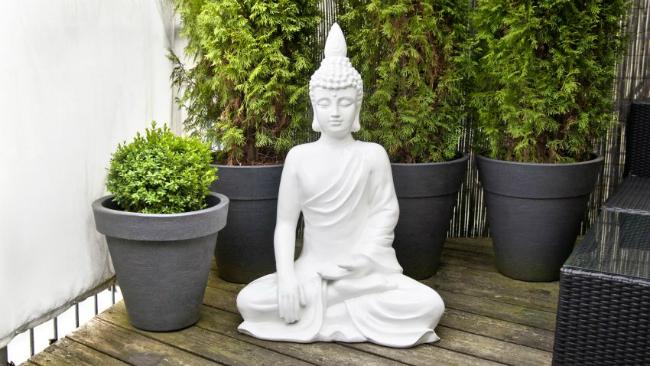 Vorgartengestaltung mit Statue