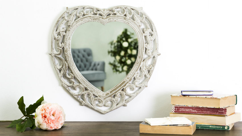 Specchio con cornice in acciaio