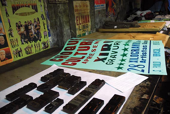 One of the posters next to the woodtype used to print it. - All photos: Felipe Lopez