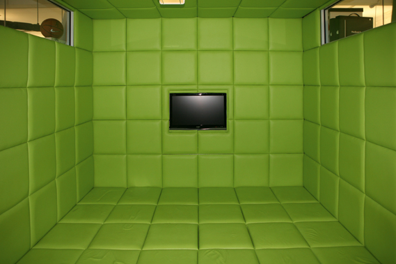 Wieden + Kennedy, London - Lime green padded cell built into its office space. 