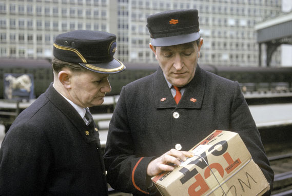 British Rail uniforms - Station inspector and porter wearing new British Rail uniforms at Waterloo station, 1966
