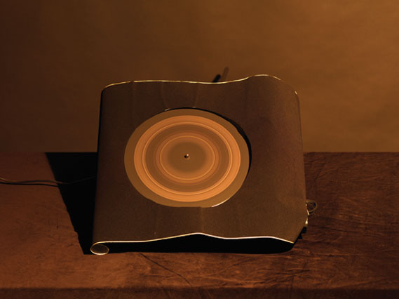 Saturn - A vinyl record was painted with lines and photographed on a long exposure as it spun