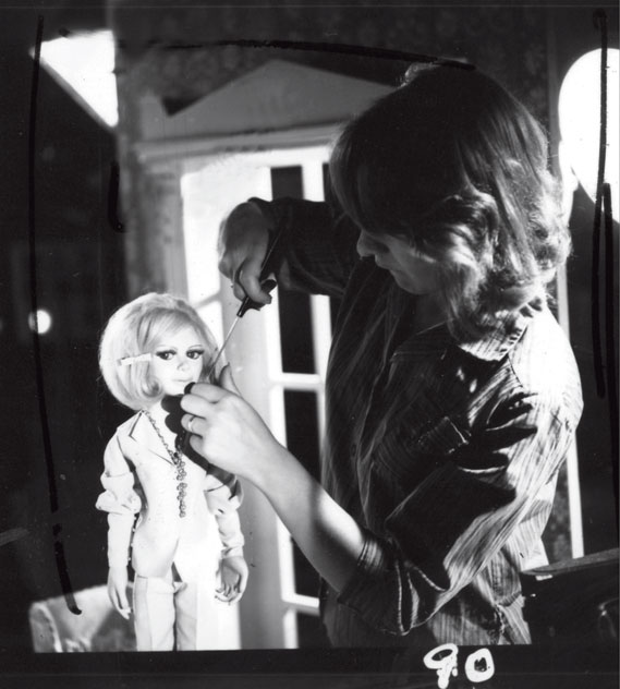 Puppeteer preparing Lady Penelope for her next scene (1965)