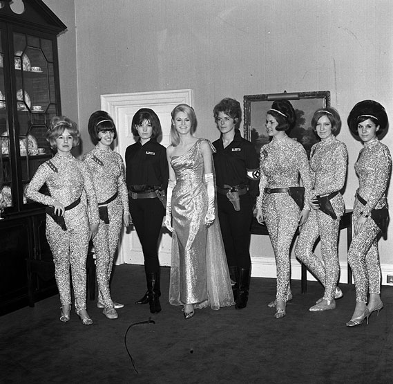 Awards dinner with staff dressed as space girls (1966)