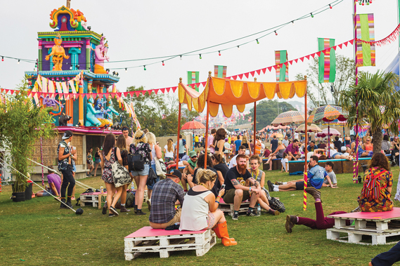 The Bollywood Tent's temple entranceway has been with Bestival since the first show in 2004, complete with beds and parasols commissioned during a trip to India. Photo by Victor Frankowski