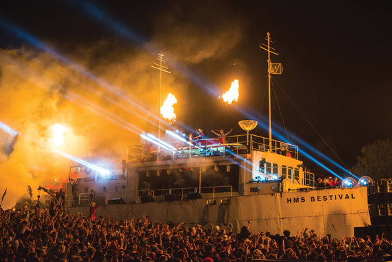 The Port, a dance music stage created for Bestival's 10 year anniversary HMS Bestival themed show in 2013, by Spatial Installations. At 24m long, it was their most ambitious project to date, created using shipping containers and clip-on steel cladding. Photo by Carolina Faruolo