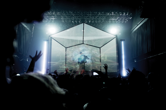 Layer 3, the tesseract structure used for Flying Lotus's You're Dead tour, created by David Wexler, John King (Timeboy) & Flying Lotus. Animations are projected onto two transparent screens, creating the illusion of 3D depth, with the musician in between, and projected visuals are taken from a library of original animations (Photo: Glenjamin Han, glenjamn.com)