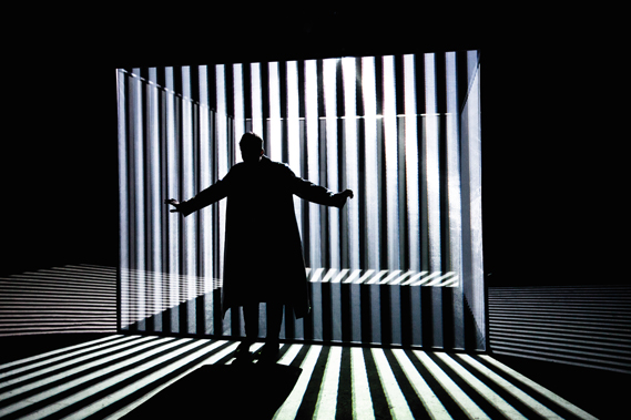 Responsive 3D environment for soul musician Jamie Lidell, designed by Flat-e, created for the video for You Naked in 2013 and has since used on tour. It is controlled by the singer via a glowing mic stand, which acts like a joystick. The projections were inspired by dazzle patterns, optical illusions and disco lights (Photo: Sandra Ciampone)