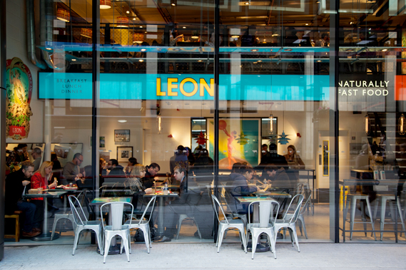 Diners at Leon's Victoria Street site, one of 21 restaurants in the UK. Furniture, fittings, signage and imagery varies in each, and Vincent says the design is often influenced by the history of the building. The brand also credits architect Jason Cooper, interior designer Bambi Sloan and Fusion Design and Architecture for helping establish the look and feel of its restaurants