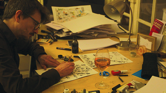 Surviving Charlie Hebdo cartoonist Luz at work. This still is taken from a filmed interview Luz gave exclusively to Vice News after the attacks. The interview appeared on Vice News in Feb 2015