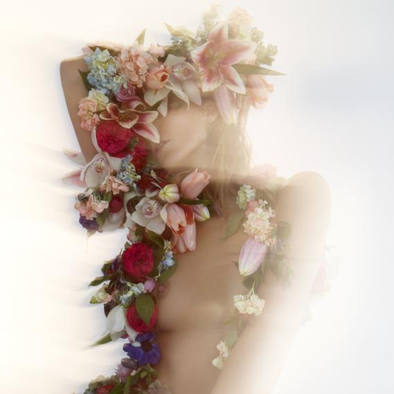 Image of Daria Werbowy, taken on set by Du Preez and Thornton Jones. Werbowy is wearing a floral sculpture by artist Rebecca Louise Law
