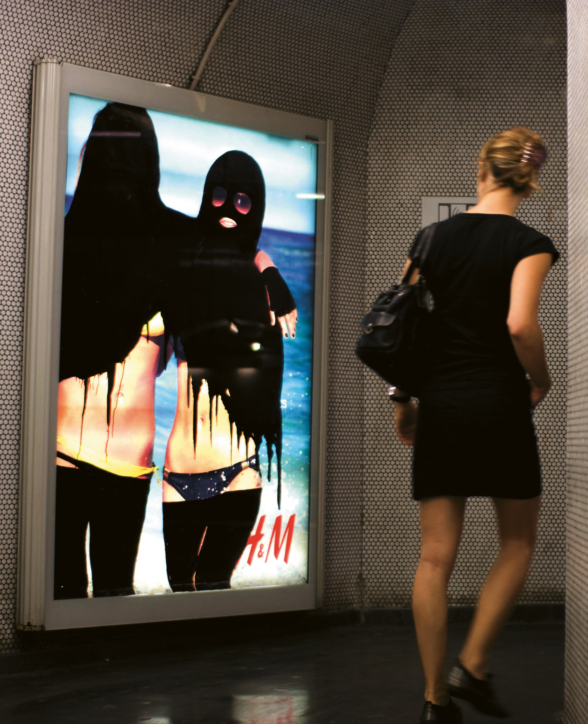 'Hijabizing' intervention in the Paris Metro by Princess Hijab, France, 2006-11. From Visual Impact (Phaidon, 2015)