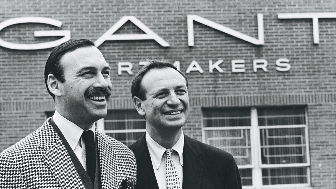 Marty and Elliot Gantmacher, whose father Bernard started the firm. The logo in the background was used as a reference for the new mark