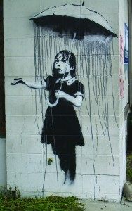 Umbrella Girl by Banksy, New Orleans, US, 2008.