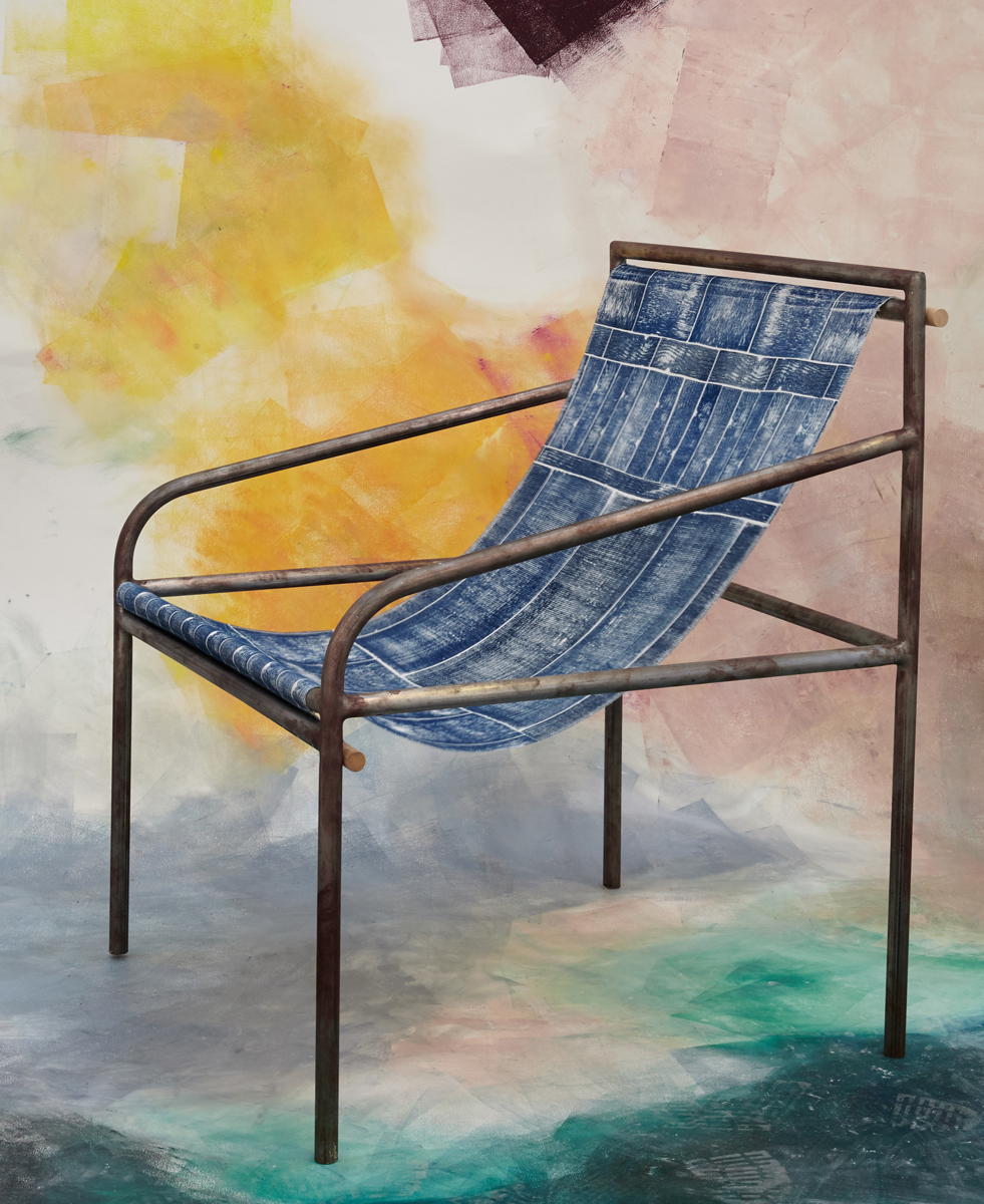 A wood block print fabric and steel chair