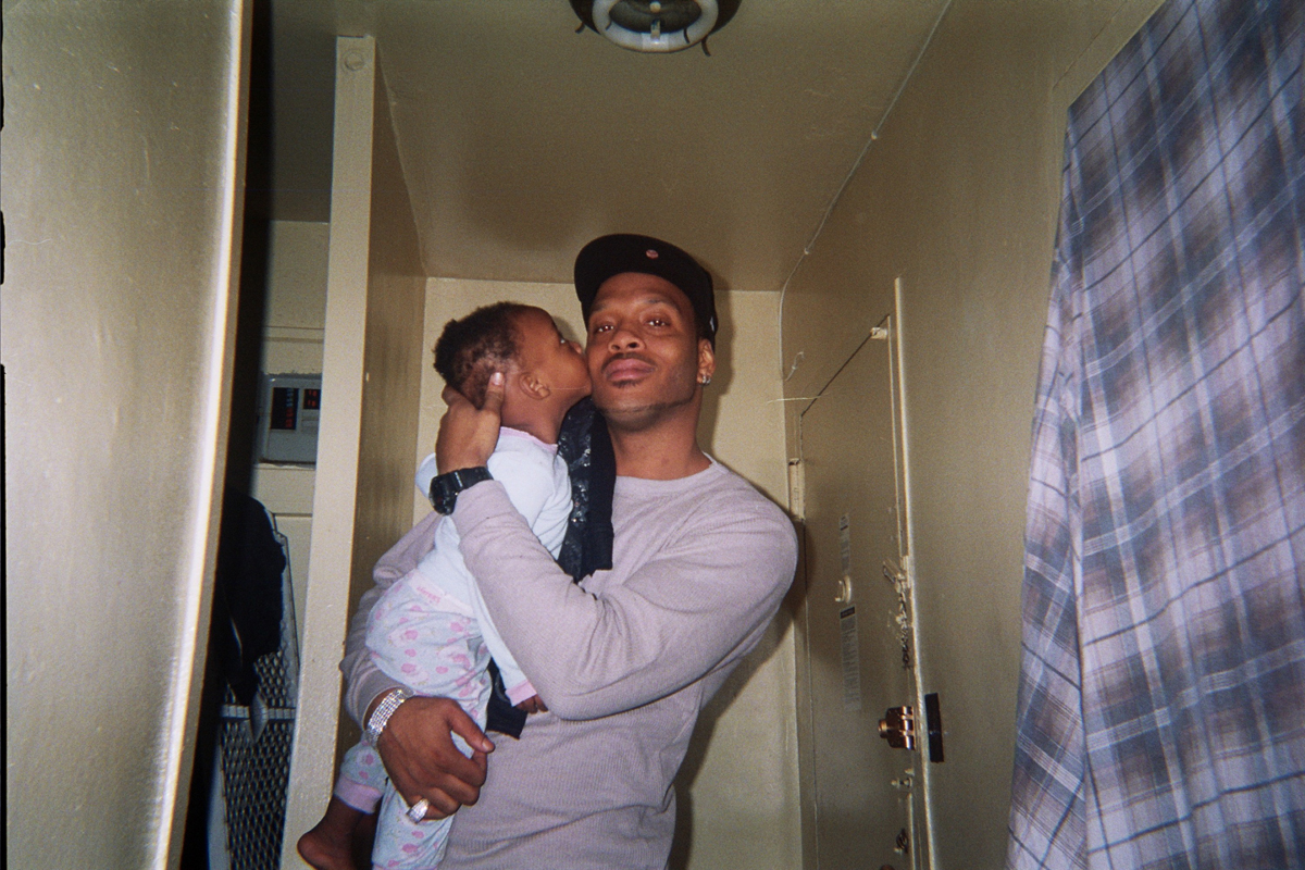 "Janyia Ford photographs her stepfather in Manhattanville Houses, Harlem. ""He said he was trying to look fly."""