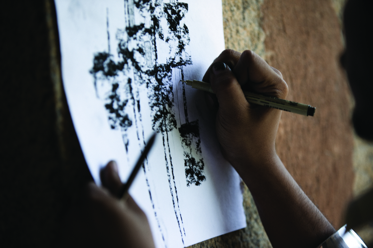 A student from India's National Institute of Fashion Technology sketching a design for forthcoming textiles range Svärtan