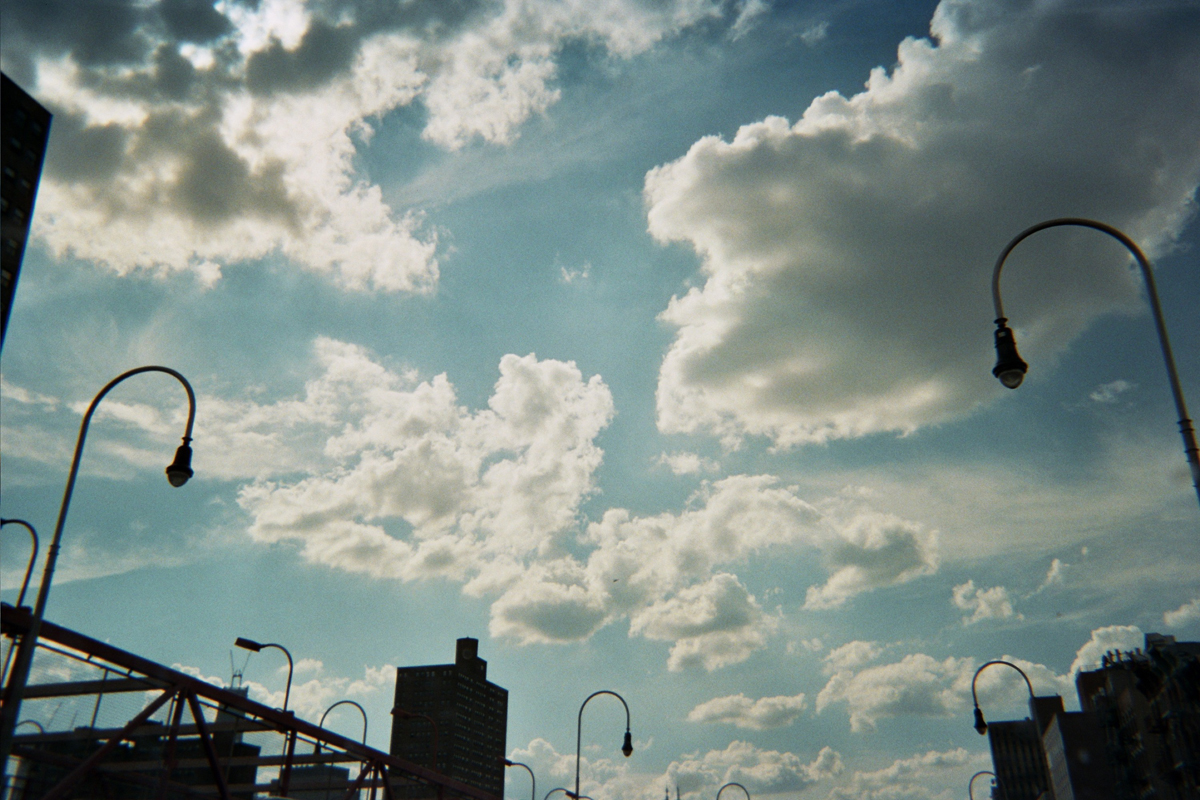 "Photograph by Sheik Bacchus, Manhattanville Houses, Harlem: ""Cloud formations. Impending rain."""