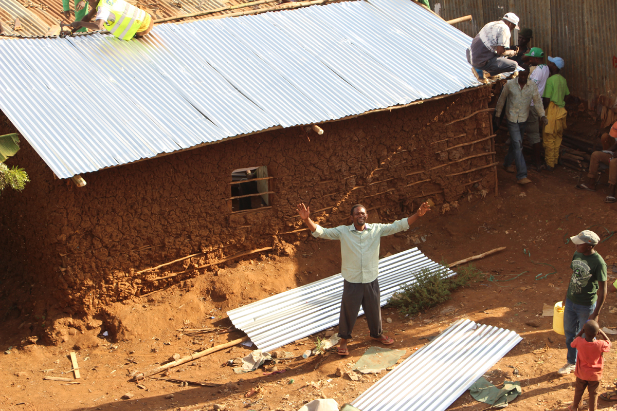 The installation of the new corrugated metal roofs funded by the project