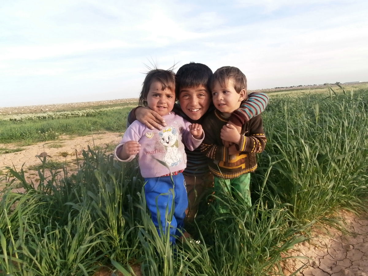 """It is really beautiful to find some grass. It reminds us of Syria in spring. It is so dry around the camp."""