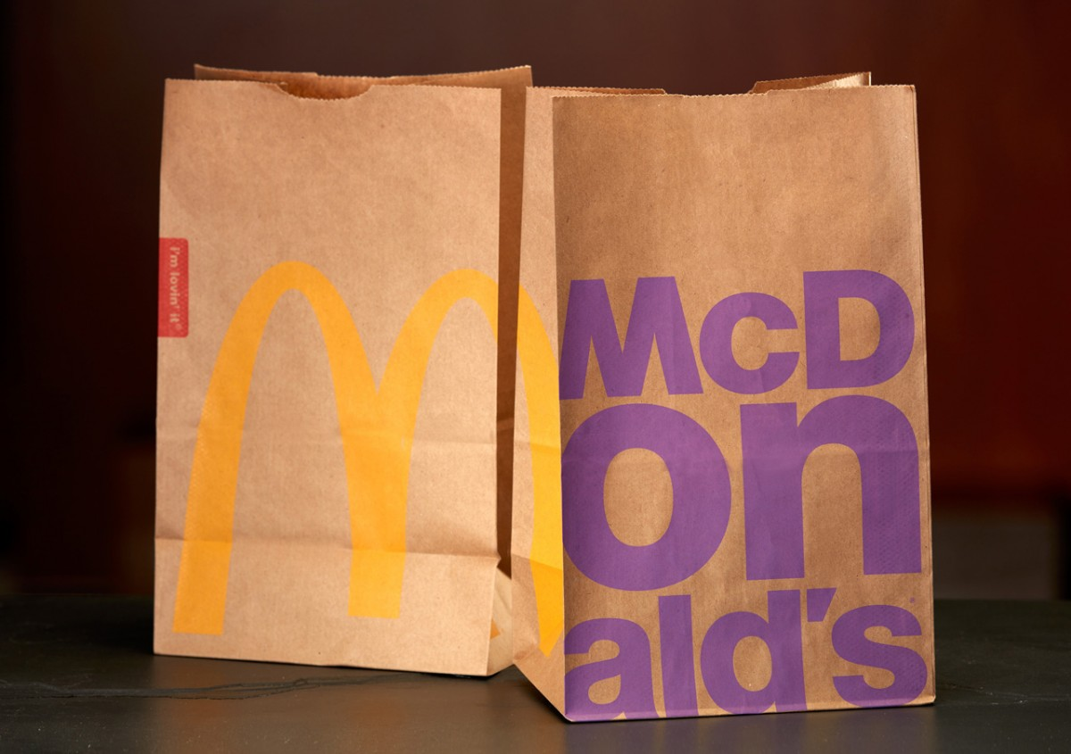 New McDonald's bags with the brand's Helvetica-based word mark front and centre. Image courtesy McDonald's