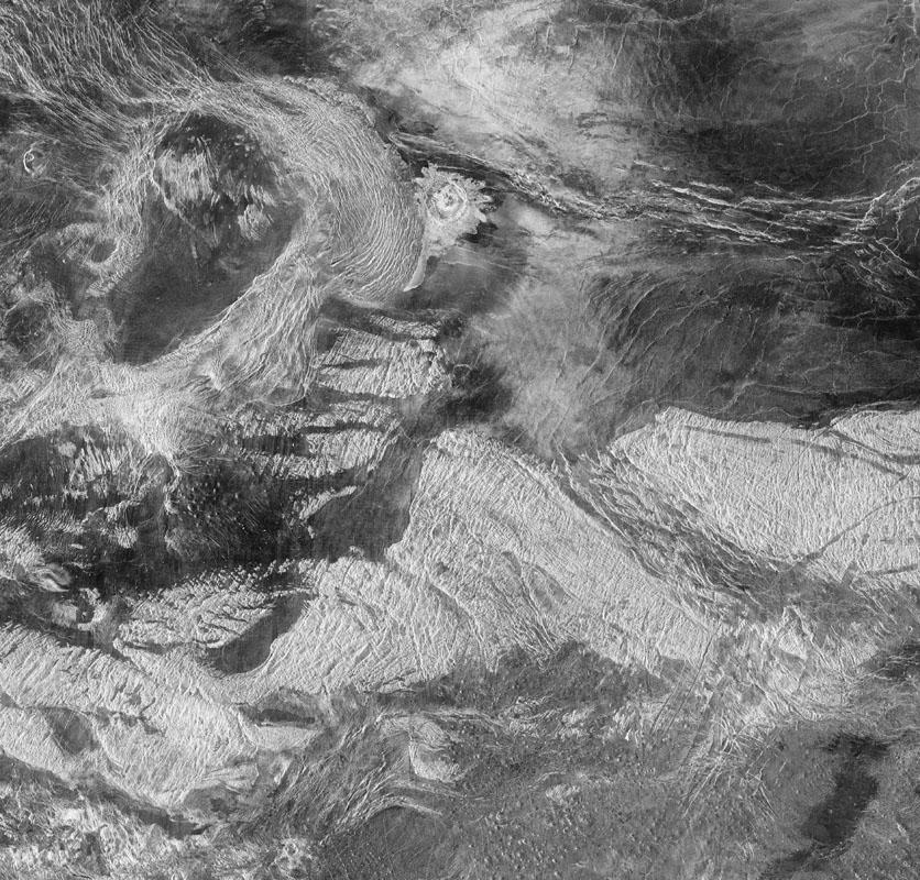 Tusholi Corona on Venus The oval-shaped feature in the upper left, Tusholi Corona overlaps La Fayette impact crater in the Tethus Regio (region) of Venus. Radar image, Magellan, Sept. 15, 1990 – Sept. 14, 1992 Credit: NASA; JPL; USGS; Michael Benson, Kinetikon Pictures