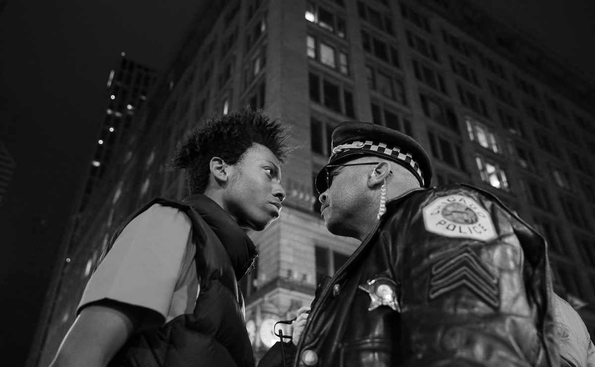 March Against Police Violence, John J. Kim, USA, 2015, Chicago Tribune. Lamon Reccord, left, scolds a police sergeant during a police violence protest and march at State and Randolph streets 25 Nov 2015, Chicago.