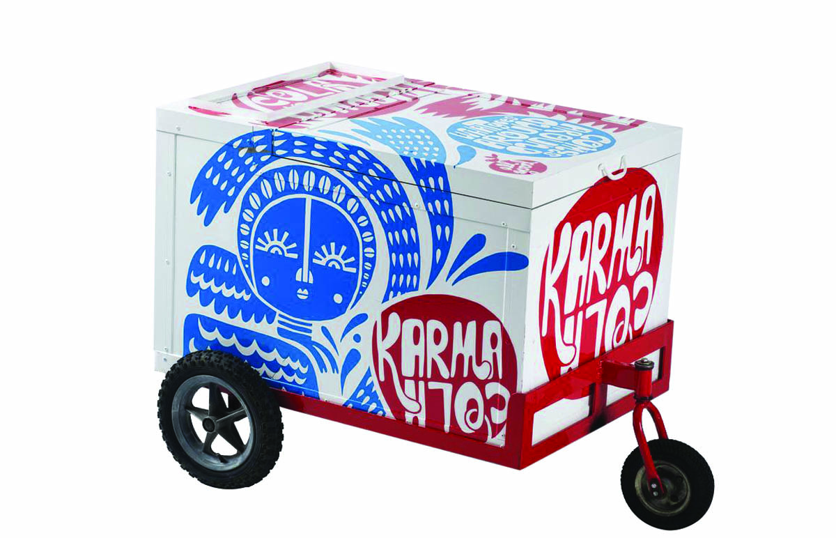 Karma Cola cart adorned with elements from illustrator Beck Wheeler's identity for the brand.